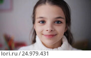 Купить «happy smiling beautiful girl in sweater at home», видеоролик № 24979431, снято 10 ноября 2016 г. (c) Syda Productions / Фотобанк Лори