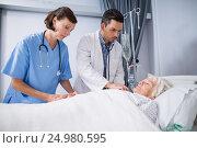 Купить «Doctors examining senior patient with stethoscope», фото № 24980595, снято 5 ноября 2016 г. (c) Wavebreak Media / Фотобанк Лори