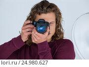 Купить «Photographer clicking a picture using digital camera», фото № 24980627, снято 1 сентября 2016 г. (c) Wavebreak Media / Фотобанк Лори