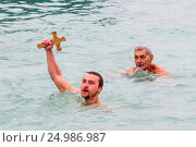 Bulgarians celebrate Epiphany with a swim in the icy waters of the... (2016 год). Редакционное фото, фотограф Impact Press Group / WENN.com / age Fotostock / Фотобанк Лори