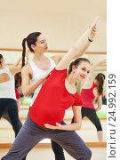 Купить «pregnant woman with personal trainer doing fitness exercise», фото № 24992159, снято 3 ноября 2015 г. (c) Дмитрий Калиновский / Фотобанк Лори