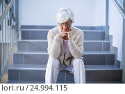 Купить «Upset senior woman sitting on stairs», фото № 24994115, снято 6 ноября 2016 г. (c) Wavebreak Media / Фотобанк Лори