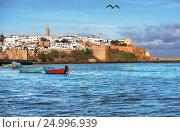 Старая крепость в Марокко с лодками на водах залива, фото № 24996939, снято 14 января 2014 г. (c) oleg savichev / Фотобанк Лори