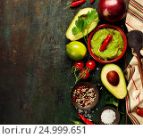 Купить «Bowl of guacamole with fresh ingredients», фото № 24999651, снято 6 декабря 2016 г. (c) Наталия Кленова / Фотобанк Лори