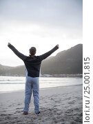 Купить «Mature man standing with arms outstretched on the beach», фото № 25001815, снято 29 сентября 2016 г. (c) Wavebreak Media / Фотобанк Лори