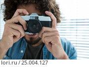 Купить «Male photographer with old fashioned camera», фото № 25004127, снято 1 сентября 2016 г. (c) Wavebreak Media / Фотобанк Лори