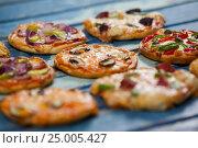 Купить «Various delicious italian pizza», фото № 25005427, снято 30 сентября 2016 г. (c) Wavebreak Media / Фотобанк Лори
