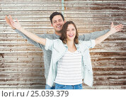 Купить «Portrait of happy couple standing with arms outstretched», фото № 25039379, снято 19 января 2019 г. (c) Wavebreak Media / Фотобанк Лори