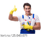 Купить «Man with cleaning agents isolated on white background», фото № 25043071, снято 31 октября 2016 г. (c) Elnur / Фотобанк Лори