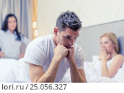 Купить «man sitting on the bed with two women on the back», фото № 25056327, снято 23 ноября 2013 г. (c) Syda Productions / Фотобанк Лори