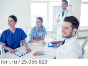 Купить «group of doctors on presentation at hospital», фото № 25056823, снято 14 марта 2015 г. (c) Syda Productions / Фотобанк Лори