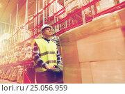 Купить «man on forklift loading cargo at warehouse», фото № 25056959, снято 9 декабря 2015 г. (c) Syda Productions / Фотобанк Лори
