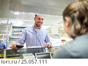 Купить «happy man with wallet at store cash register», фото № 25057111, снято 21 октября 2016 г. (c) Syda Productions / Фотобанк Лори