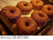 Купить «close up of donuts at bakery or grocery store», фото № 25057583, снято 2 ноября 2016 г. (c) Syda Productions / Фотобанк Лори