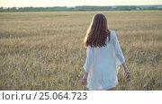 Купить «Young beautiful woman outdoors», видеоролик № 25064723, снято 19 октября 2019 г. (c) Raev Denis / Фотобанк Лори