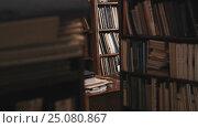 Купить «Bookcases full of books and document folders in old style library. Dolly shot», видеоролик № 25080867, снято 11 октября 2016 г. (c) Александр Багно / Фотобанк Лори