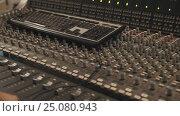 Close up dolly shot of computer keyboard laying on music mixing console. Стоковое видео, видеограф Александр Багно / Фотобанк Лори