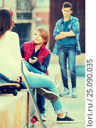 Upset boy and couple of teens apart on the street. Стоковое фото, фотограф Яков Филимонов / Фотобанк Лори
