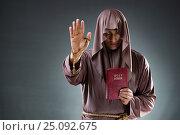 Купить «Monk in religious concept on gray background», фото № 25092675, снято 26 октября 2016 г. (c) Elnur / Фотобанк Лори