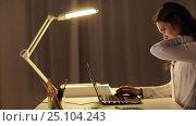 Купить «tired woman typing on laptop at night office», видеоролик № 25104243, снято 16 декабря 2016 г. (c) Syda Productions / Фотобанк Лори