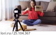 Купить «woman with camera recording video at home», видеоролик № 25104367, снято 3 января 2017 г. (c) Syda Productions / Фотобанк Лори