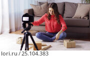 Купить «woman with camera recording video at home», видеоролик № 25104383, снято 3 января 2017 г. (c) Syda Productions / Фотобанк Лори