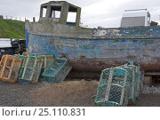 Купить «Old delapidated fishing boat and creels lie ashore. Spring 2005.», фото № 25110831, снято 19 ноября 2018 г. (c) Nature Picture Library / Фотобанк Лори