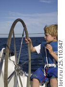 Купить «Little boy taking the wheel and eating a biscuit on a cruising yacht, Mexico.», фото № 25110847, снято 24 июня 2019 г. (c) Nature Picture Library / Фотобанк Лори