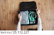 Купить «hands packing travel bag with personal stuff», видеоролик № 25112227, снято 13 января 2017 г. (c) Syda Productions / Фотобанк Лори