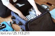 Купить «hands packing travel bag with personal stuff», видеоролик № 25113211, снято 13 января 2017 г. (c) Syda Productions / Фотобанк Лори