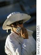 Купить «A crew member of a superyacht uses a handheld VHF radio to communicate 1994.», фото № 25116051, снято 23 июля 2018 г. (c) Nature Picture Library / Фотобанк Лори