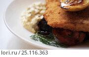 Купить «close up of fish salad with roasted lemon on plate», видеоролик № 25116363, снято 17 января 2017 г. (c) Syda Productions / Фотобанк Лори