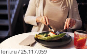 Купить «woman eating caviar toast skagen at restaurant», видеоролик № 25117059, снято 17 января 2017 г. (c) Syda Productions / Фотобанк Лори