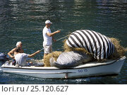 Купить «Boat loaded with hay travelling from one island to another, Croatia. August 2006», фото № 25120627, снято 27 апреля 2018 г. (c) Nature Picture Library / Фотобанк Лори