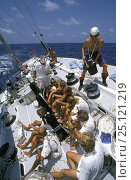"""Купить «Crew aboard """"The Card"""" as they cross the equator during the Whitbread Round the World Race, 1989.», фото № 25121219, снято 23 июня 2018 г. (c) Nature Picture Library / Фотобанк Лори"""