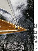 Купить «Aerial view of a bowman aboard a classic cruising yacht.», фото № 25121527, снято 9 апреля 2020 г. (c) Nature Picture Library / Фотобанк Лори