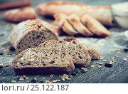 Купить «Loaf of bread on a wooden board», фото № 25122187, снято 18 октября 2016 г. (c) Татьяна Яцевич / Фотобанк Лори