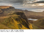 Купить «View to The Quiraing from the Trotternish Ridge at dawn, Isle of Skye, Inner Hebrides, Scotland, UK, April 2016.», фото № 25126935, снято 14 августа 2018 г. (c) Nature Picture Library / Фотобанк Лори