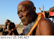 Купить «Himba man smoking a pipe, Marienfluss Valley. Kaokoland, Namibia. October 2015», фото № 25140427, снято 5 августа 2020 г. (c) Nature Picture Library / Фотобанк Лори