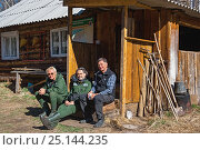 Купить «Dimitry Melamed (centre) with photographer Michel Roggo (right) on location for his Freshwater Project, sitting next to cabin, Lake Baikal, Temnik River, Baikalsky Reserve, Siberia, Russia. May 2015», фото № 25144235, снято 26 июня 2019 г. (c) Nature Picture Library / Фотобанк Лори
