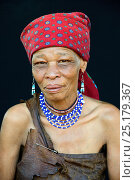 Купить «Portrait of Naro San woman wearing traditional clothing and headdress, Kalahari, Ghanzi region, Botswana, Africa. October 2014.», фото № 25179367, снято 22 мая 2019 г. (c) Nature Picture Library / Фотобанк Лори