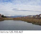 Купить «Река Мзымта в Адлере, здания на набережной, снежные горы на горизонте», фото № 25193427, снято 11 января 2017 г. (c) DiS / Фотобанк Лори