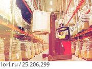 Купить «man on forklift loading cargo at warehouse», фото № 25206299, снято 9 декабря 2015 г. (c) Syda Productions / Фотобанк Лори