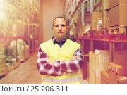 Купить «man in reflective safety vest at warehouse», фото № 25206311, снято 9 декабря 2015 г. (c) Syda Productions / Фотобанк Лори