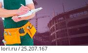 Купить «Carpenter with clipboard in building site with pink overlay», фото № 25207167, снято 25 февраля 2020 г. (c) Wavebreak Media / Фотобанк Лори
