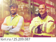 Купить «smiling men in reflective uniform at warehouse», фото № 25209087, снято 9 декабря 2015 г. (c) Syda Productions / Фотобанк Лори