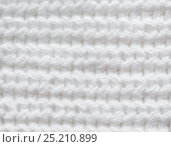 Купить «close up of knitted item», фото № 25210899, снято 15 сентября 2016 г. (c) Syda Productions / Фотобанк Лори