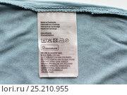 Купить «label with users manual of clothing item», фото № 25210955, снято 15 сентября 2016 г. (c) Syda Productions / Фотобанк Лори
