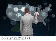 Купить «businessman touching virtual screen with contacts», фото № 25212171, снято 29 января 2015 г. (c) Syda Productions / Фотобанк Лори
