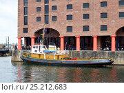 Купить «Veteran Mersey tugboat Brocklebank, berthed in the Albert Dock during the Battle of the Atlantic 70th Anniversary commemoration (BOA70), Liverpool, Merseyside...», фото № 25212683, снято 22 мая 2018 г. (c) Nature Picture Library / Фотобанк Лори